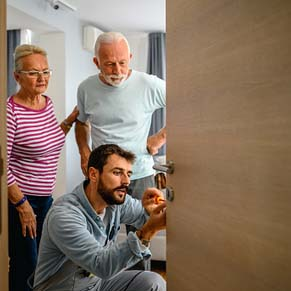 locksmith repairs door for pensioners